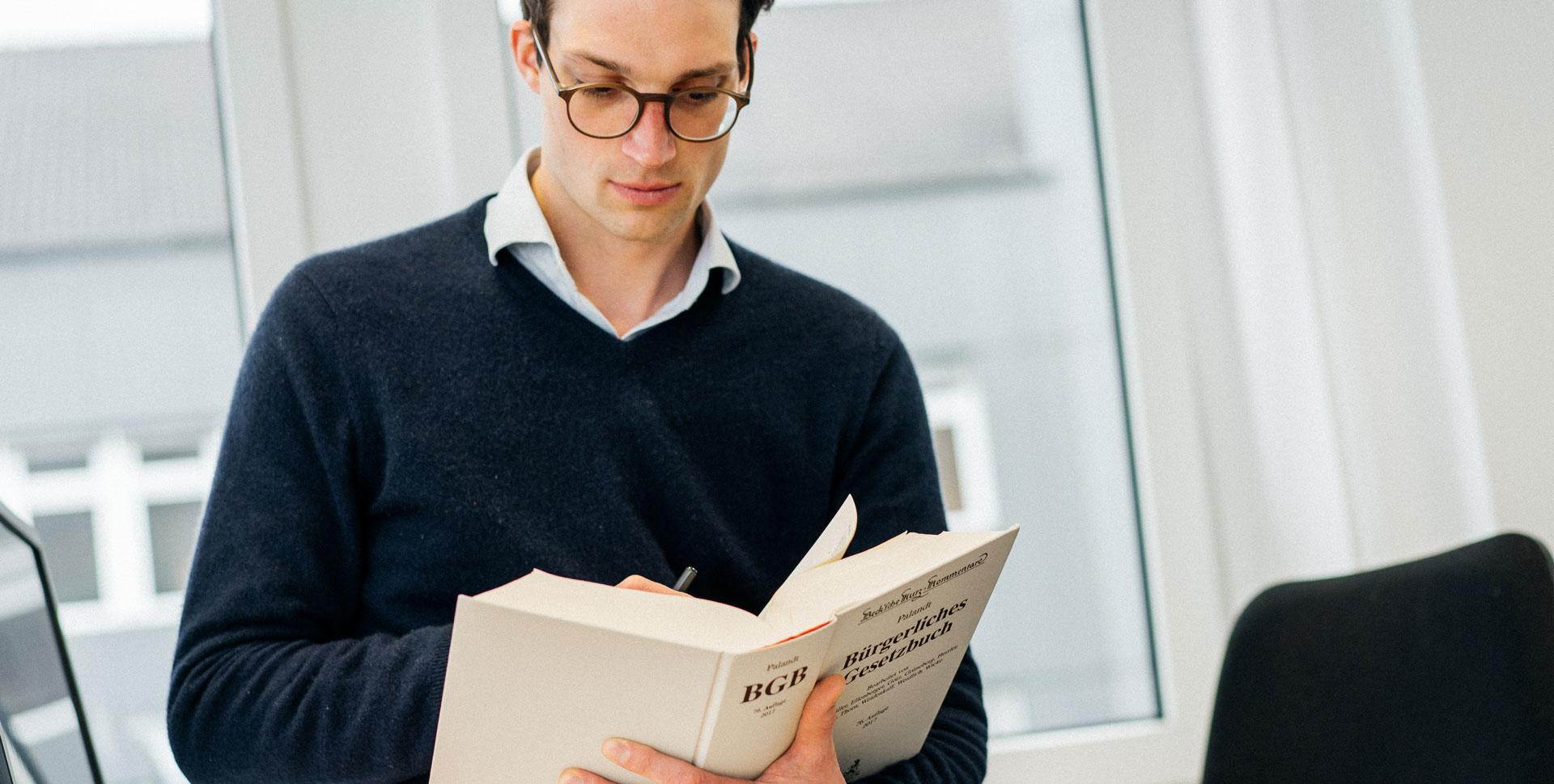 A member of SkySails Legal Department studying the german civil code